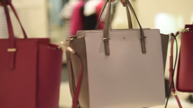 interior shots of kate spade handbags for sale inside one of their store locations in corte madera california close up shots of kate spade logos and... - handbag stock videos & royalty-free footage
