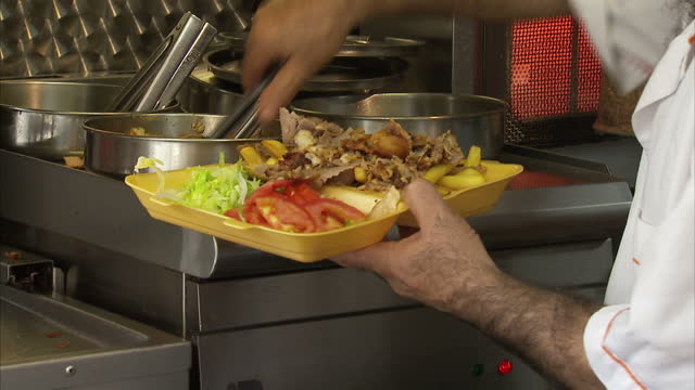 interior shots of kebabs being served up in a kebab shop on september 25 2016 in london england - unhealthy eating stock videos & royalty-free footage