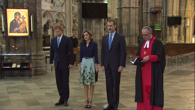 Interior shots of King Felipe and Queen Letizia of Spain paying their respects at the Tomb of the Unknown Warrior in Westminster Abbey accompanied by...