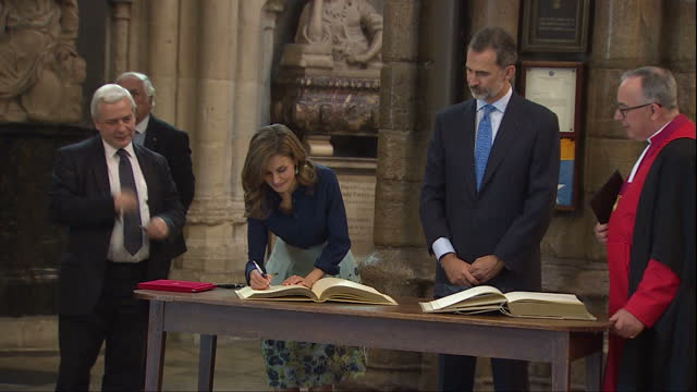 interior shots of king felipe and queen letizia of spain signing the visitors' book after touring westminster abbey accompanied by prince harry on... - queen letizia of spain stock videos and b-roll footage