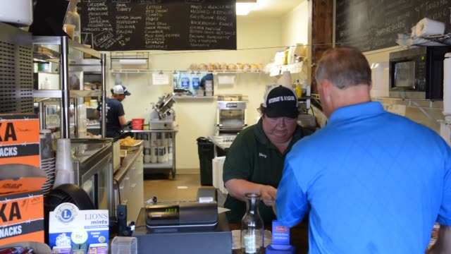 Interior shots of Kramers Kitchen restaurant and catering in Princeton Illinois A customer approaches the counter and places an order with an...