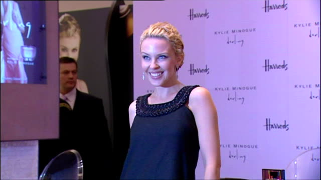 Interior shots of Kylie Minogue posing for photos at the launch of her new perfume 'Darling' in Harrods on February 09 2007 in London England
