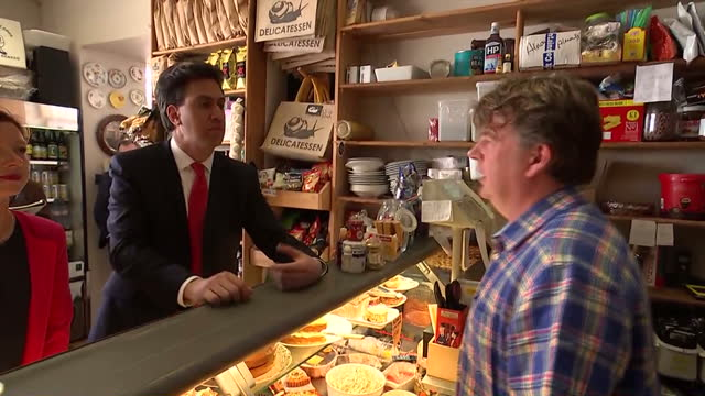 interior shots of labour leader ed miliband in a cardiff delicatessen buying welsh cakes on april 28, 2015 in cardiff, wales. - typisch walisisch stock-videos und b-roll-filmmaterial