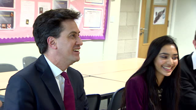 interior shots of labour leader ed miliband mp walking into a classroom of secondary school children taking seat and answering questions from them on... - ed miliband stock-videos und b-roll-filmmaterial