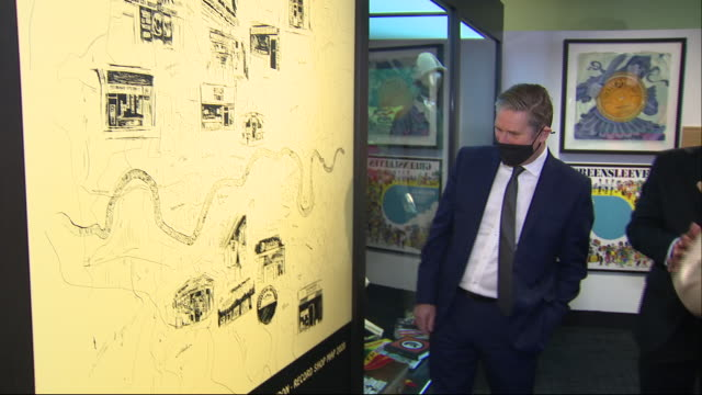 interior shots of labour leader sir keir starmer on a visit to the london museum meeting staff and looking at an exhibition of record covers on 1... - keir starmer stock videos & royalty-free footage