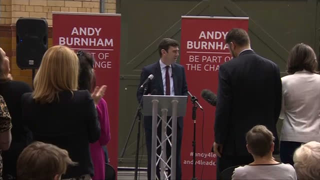 Interior shots of Labour leadership hopeful Andy Burnham arriving at a podium before making a speech to supporters on August 172015 in Manchester...
