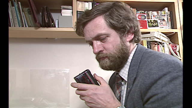 interior shots of labour mp for islington north jeremy corbyn sitting at a desk looking through paperwork and writing a letter on 6 november 1990 in... - archives stock videos & royalty-free footage