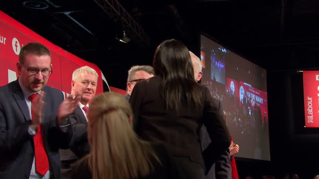 interior shots of labour party leader jeremy corbyn mp applauding after speech and giving thumbs up and joined on stage by fellow labour politicians... - diane abbott stock videos & royalty-free footage