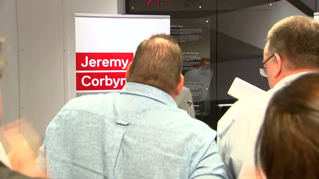 interior shots of labour party leader jeremy corbyn walking up to a podium on stage to begin his speech on august 4, 2016 in dagenham, england. - オーウェン・ウィルソン点の映像素材/bロール