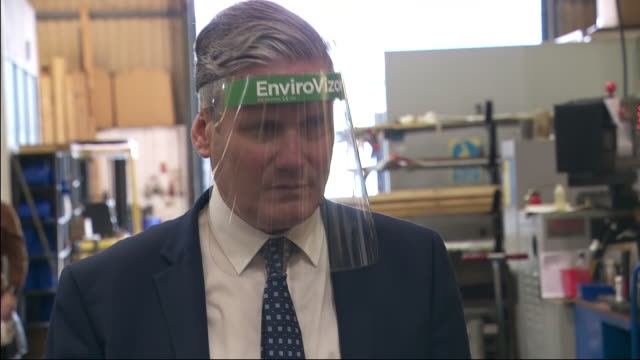 interior shots of labour party leader sir keir starmer arriving at beard and fitch engineering factory wearing a protective visor walking around the... - film leader stock videos & royalty-free footage