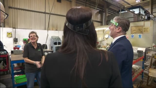 interior shots of labour party leader sir keir starmer visiting beard and fitch engineering factory wearing a protective visor walking around the... - film leader stock videos & royalty-free footage