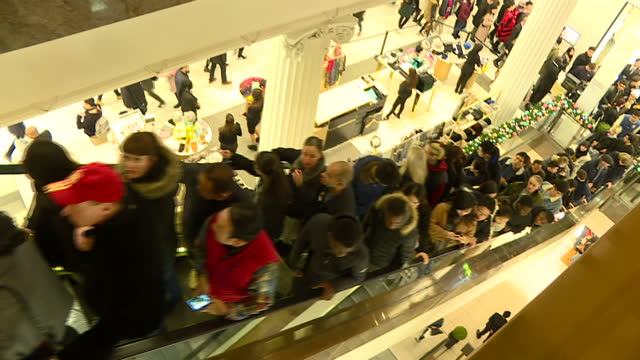 interior shots of large numbers of boxing day sales shoppers in selfridges hunting out bargains on december 26, 2016 in london, england. - sale stock videos & royalty-free footage