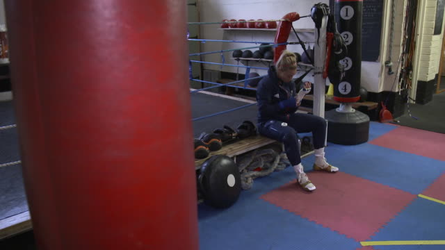 interior shots of lauren price part of team gb for the tokyo 2020 summer olympics at training putting her hand wraps shot on january 13th 2020 - punch bag stock videos & royalty-free footage