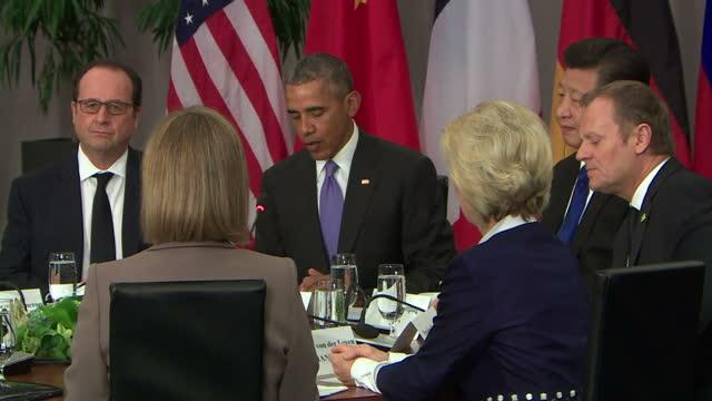Interior shots of leaders and politicians including US President Barack Obama UK Prime Minister David Cameron French President Francois Hollande US...