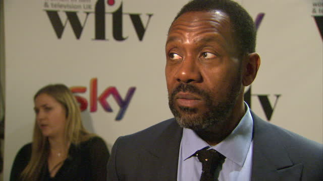vídeos de stock e filmes b-roll de interior shots of lenny henry giving an interview on the red carpet at women in film & tv awards at london hilton on december 06, 2013 in london,... - lenny henry