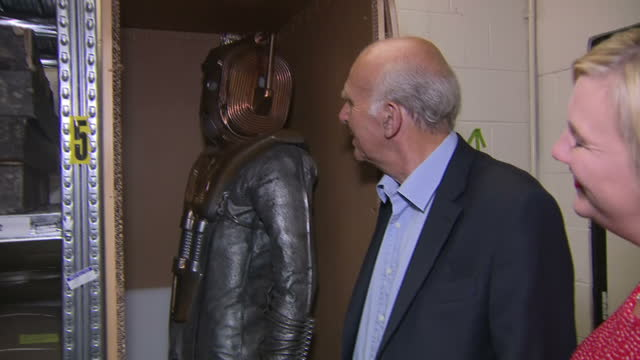 interior shots of liberal democrat leader sir vince cable looking at a cyberman costume from the doctor who collection in storage at the manchester... - doctor who stock videos & royalty-free footage