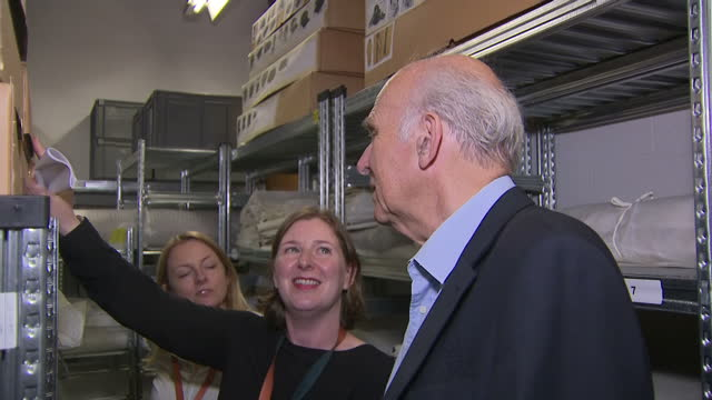 stockvideo's en b-roll-footage met interior shots of liberal democrat leader sir vince cable visiting the manchester science and industry museum and viewing some of the items from the... - doctor who