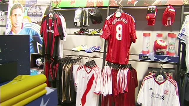 interior shots of liverpool football memorabilia including steven gerrard shirts on sale in the club shop of the guoan workers stadium the home of... - major league soccer stock videos and b-roll footage