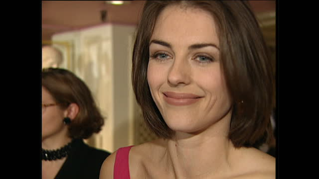 Interior shots of Liz Hurley speaking to reporters at the BAFTA after show party on April 23 1995 in London England