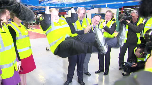 interior shots of london mayor boris johnson swinging from bars of a chassis at the wrightbus plant on february 29 2016 in antrim northern ireland - joker card stock videos and b-roll footage