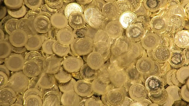 interior shots of machinery in the royal mint manufacturing new coins with pound coins tumbling from a chute on 10 july 2017 in llantrisant united... - royal mint stock videos & royalty-free footage