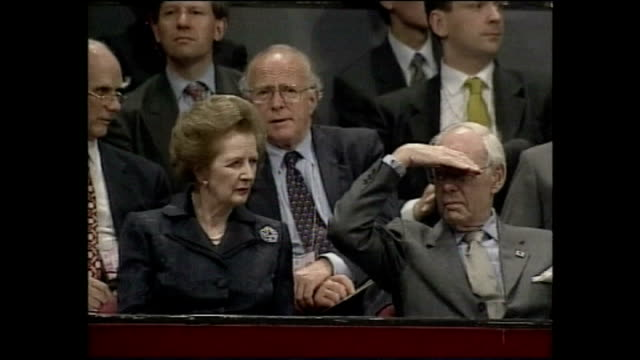 interior shots of margaret thatcher baroness thather sat next to denis thatcher at the hong kong handover ceremony on 30 june 1997 in hong kong - 式典点の映像素材/bロール