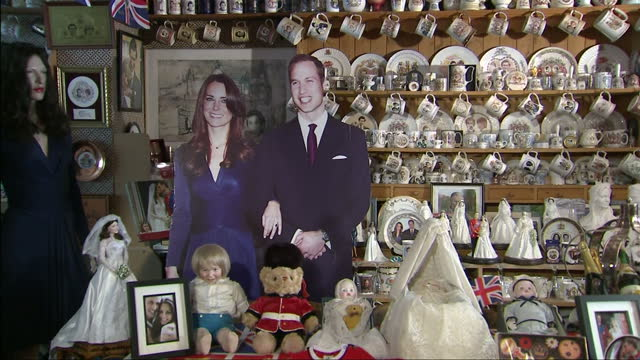 interior shots of margaret tyler's extensive collection of royal memorabilia including crockery toys pictures in photo frames giant card cut outs of... - souvenir stock videos and b-roll footage