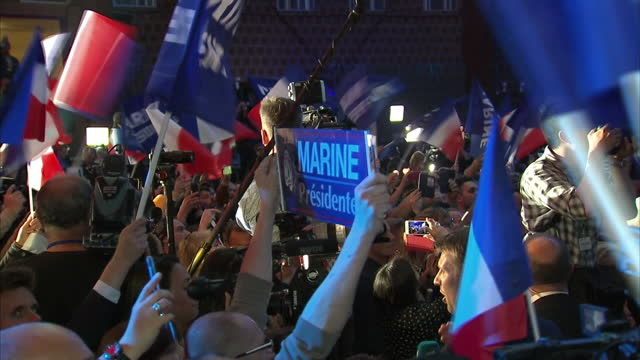 interior shots of marine le pen on stage during an election rally and meeting cheering supporters on 23 april 2017 in henin beaumont france - national front stock videos & royalty-free footage