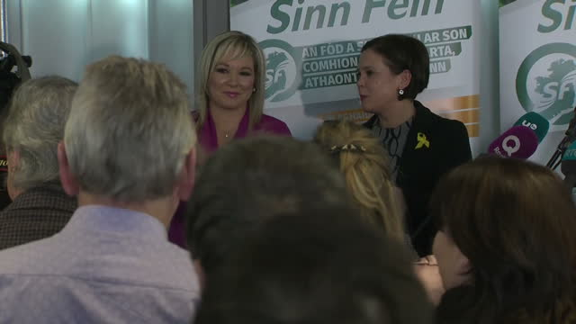 Interior shots of Mary Lou McDonald receiving applause and congratulations from Gerry Adams and Michelle O'Neill and other officials after giving a...