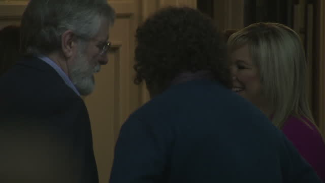 Interior shots of Mary Lou McDonald speaking to Gerry Adams and Michelle O'Neill and being congratulated by other Sinn Fein officials before walking...