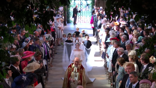 interior shots of meghan markle walking down the aisle of st george's chapel as she meets prince harry at the alter including shots of paige boys and... - hochzeit stock-videos und b-roll-filmmaterial