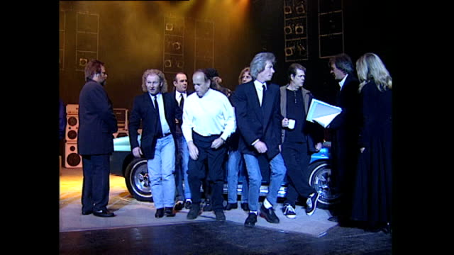 Interior shots of members of Status Quo and The Beach Boys posing in front of car during concert rehearsal including Francis Rossi Rick Parfitt Brian...