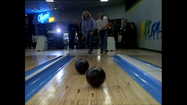 interior shots of members of status quo rick parfitt and francis rossi throwing bowling balls at bowling alley on november 10 1993 in london england - guitarist stock videos & royalty-free footage