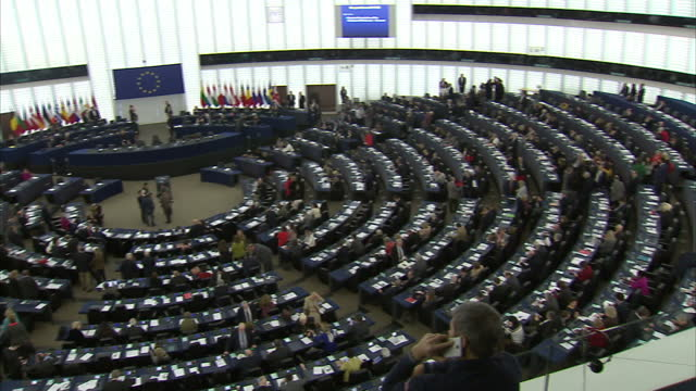 interior shots of mep's taking their seats in the hemicycle and speaking together before a plenary session begins and martin schulz president of the... - parliament building stock videos & royalty-free footage