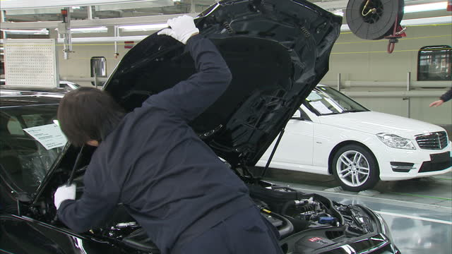interior shots of mercedes cars on production line at the company's beijing plant on january 15 2014 in beijing china - mercedes benz stock videos & royalty-free footage