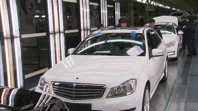 interior shots of mercedes cars on production line in beijing plant on january 15, 2014 in beijing, china. - mercedes benz stock videos & royalty-free footage