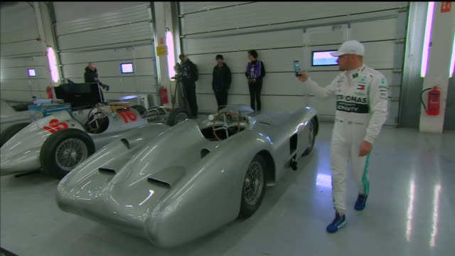 interior shots of mercedes formula 1 driver valtteri bottas looking at classic mercedes cars, followed by exterior shots of bottas driving a classic... - silverstone stock videos & royalty-free footage