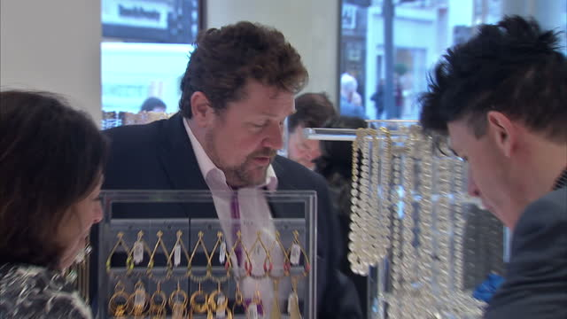 interior shots of michael ball chatting to staff over counter at fenwicks of bond street at charity event for acting for others on april 10 2014 in... - michael ball bildbanksvideor och videomaterial från bakom kulisserna