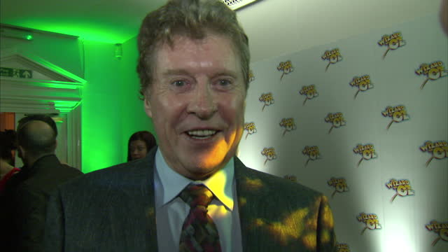 interior shots of michael crawford giving an interview on the red carpet at the wizard of oz premiere at one marylebone on march 1, 2011 in london,... - michael crawford点の映像素材/bロール