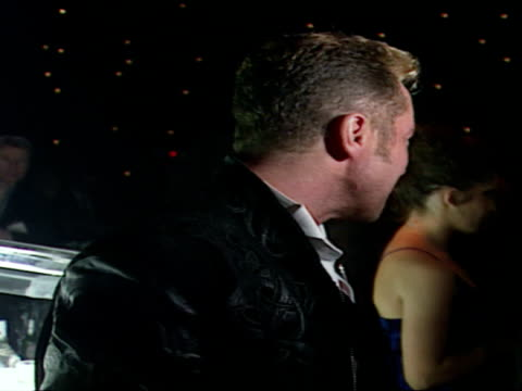 vidéos et rushes de interior shots of michael flatley standing at bar and drinking from shot glass before posing for photos. michael flatley posing for photos in... - programme de télévision