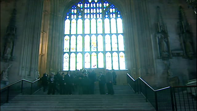 interior shots of michael jackson accompanied by david blaine and uri geller as they have tour of houses of parliament - マイケル・ジャクソン点の映像素材/bロール
