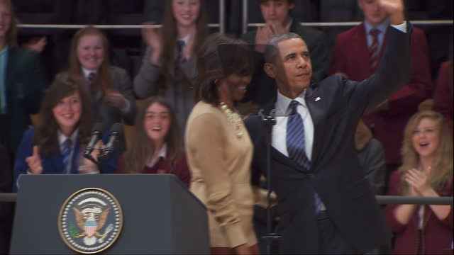 interior shots of michelle obama barack obama kiss on stage after michelle delivers her speech at waterfront hall conference centre ahead of the g8... - g8 summit stock videos & royalty-free footage