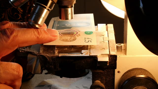 Interior shots of micro artist Graham Short needle etching and engraving via microscope portrait of Jane Austen on to a British five pound note on...