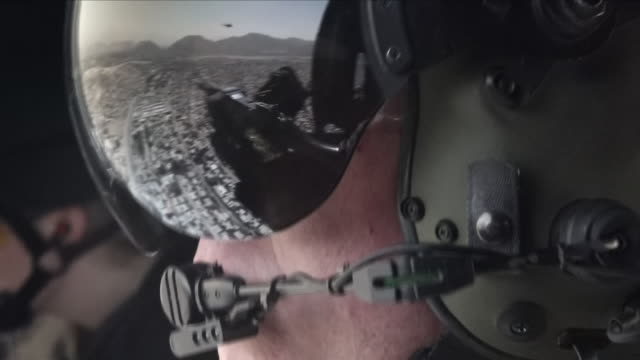 interior shots of military helicopter pilot's helmet in which reflection kabul and helicopter in flight are seen on 30 august 2018 in kabul... - helicopter pilot stock videos & royalty-free footage
