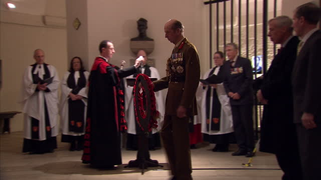 interior shots of military officers and officials including the duke of kent taking part in a memorial wreath laying ceremony in the crypt of st... - crypt stock videos & royalty-free footage
