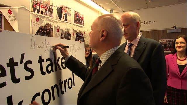 vídeos de stock e filmes b-roll de interior shots of mps including priti patel iain duncan smith chris grayling theresa villiers john whittingdale michael gove signing a poster board... - comício político