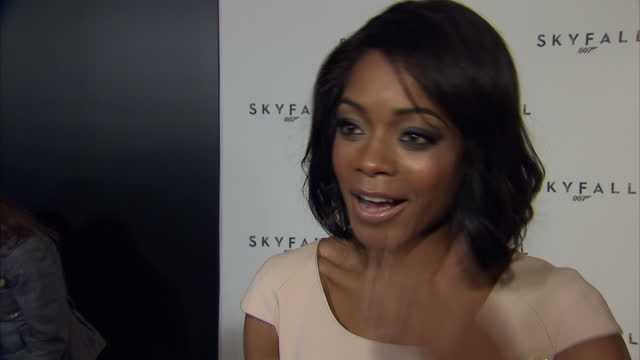 interior shots of naomie harris at james bond 23 naming launch being interviewed talking about being a bond girl the secrecy mgm's bankruptcy and the... - bond girl fictional character stock videos & royalty-free footage