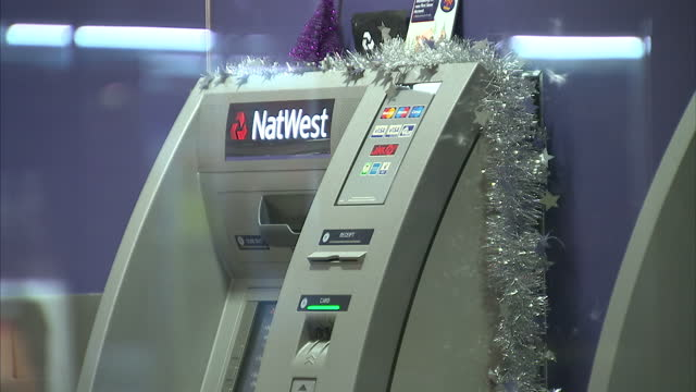 interior shots of natwest atm machines decorated with tinsel in preparation for christmas rbs technical glitch prevents customers from using their... - tinsel stock videos & royalty-free footage