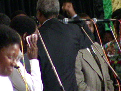 interior shots of nelson mandela dancing his way off the stage celebrating election victory and hugging and talking to various people as he walks... - nelson mandela stock videos and b-roll footage