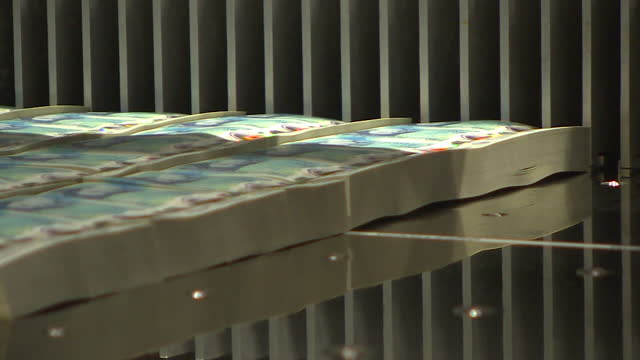 interior shots of new five pound plastic polymer banknotes on printing production line and stacks of newly printed notes on the 2nd june 2016 in... - number 5 stock videos & royalty-free footage